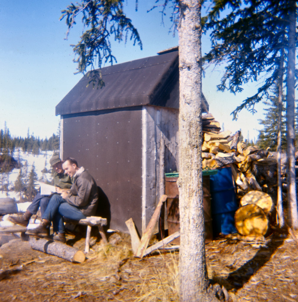 122-Boys-study-against-warm-wall-of-outhouse1968