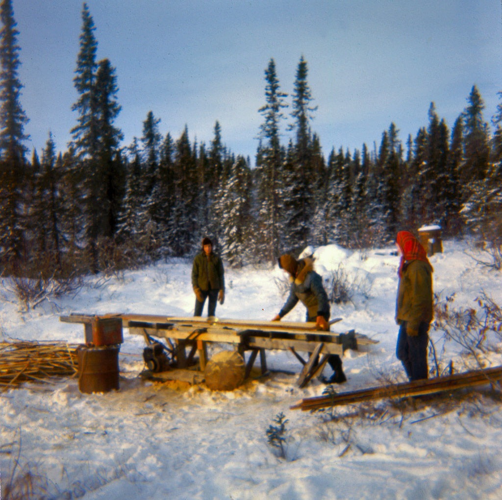 1960s Gary, Oliver and Dorene sawing lumber at our sawmill.