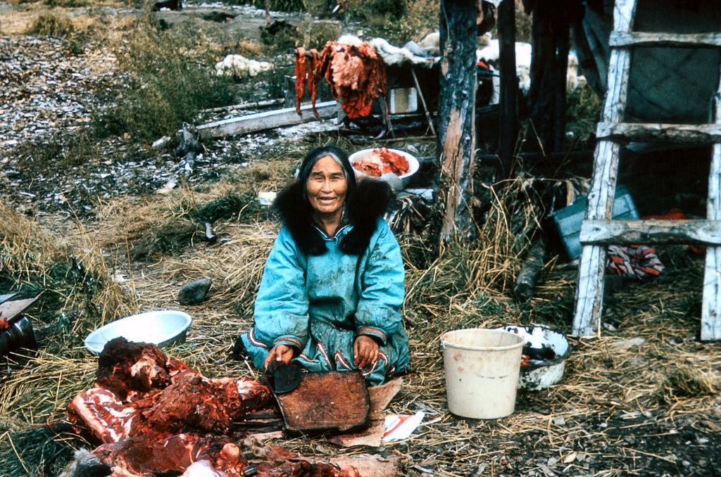 1967 Dora Johnson cutting up a moose.