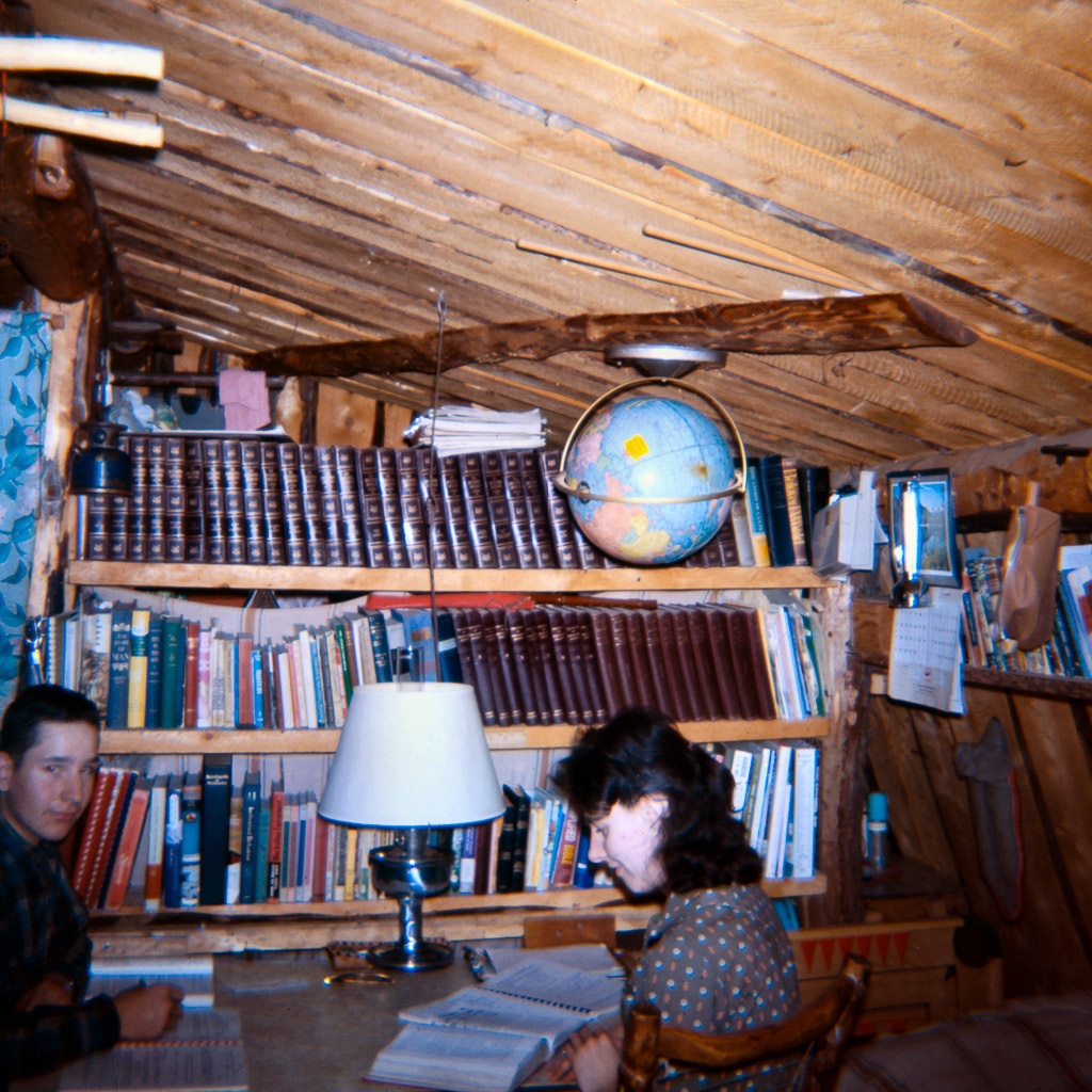 64-Gary-and-Dorene-studying-kerosene-lamp
