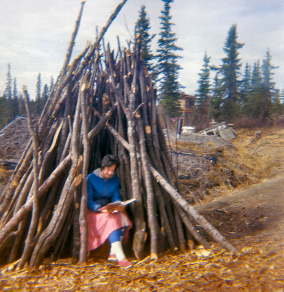 Late 1960s Dorene studying in woodpile.