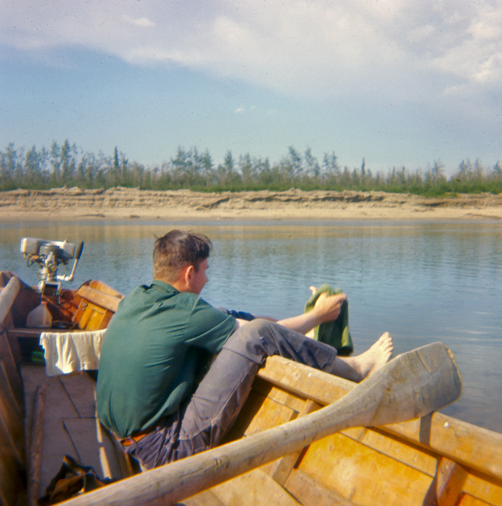Late-1960s-Gerald-in-our-boat.-Very-small-outboard-engine.-Perhaps-3-HP-tif