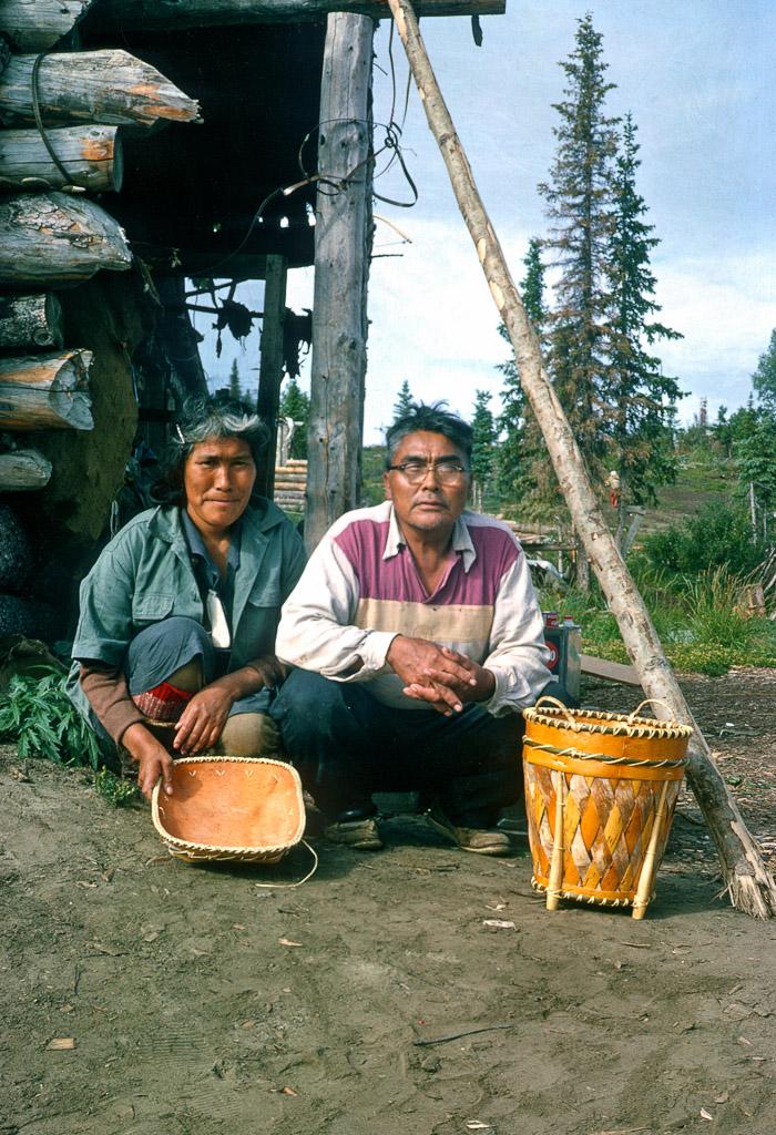 Olive and Mark Cleveland, Ambler Village residents displaying handcrafted birchbark baskets.  Ambler Alaska, 1964