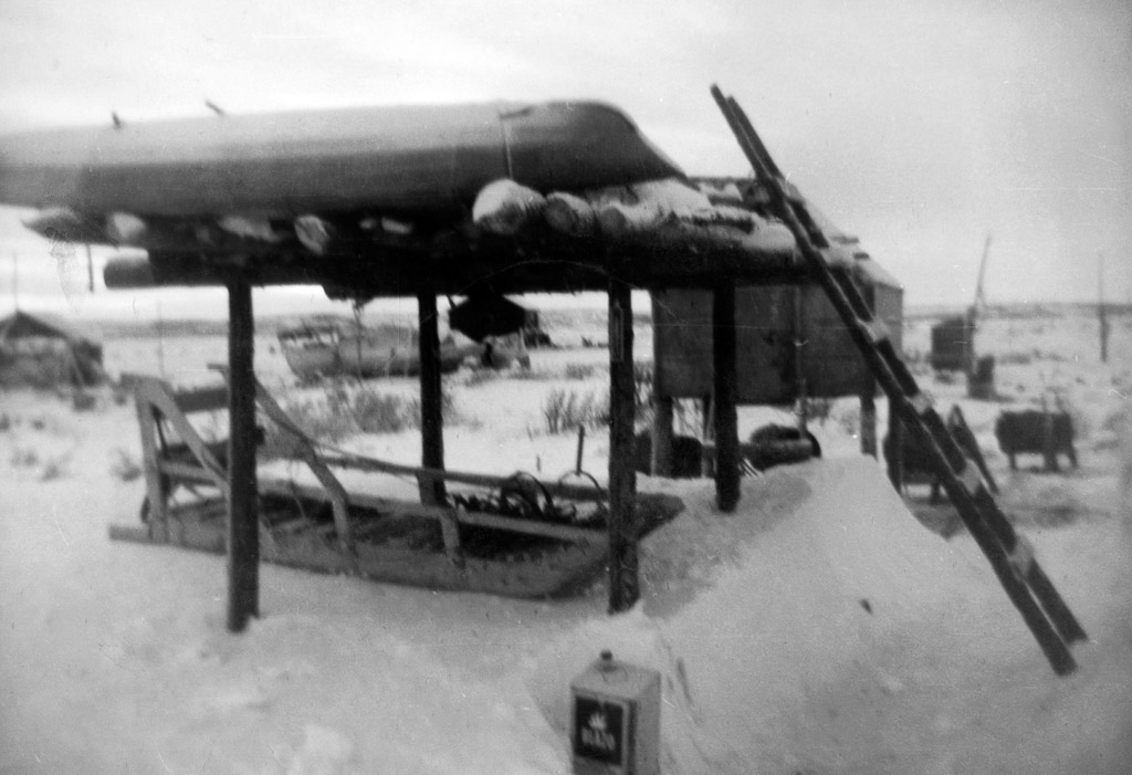 1958_cache_sled_underneath_kayak_on_top_kotzebue