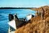 Caribou hunt by boat. Kobuk River in the fall.