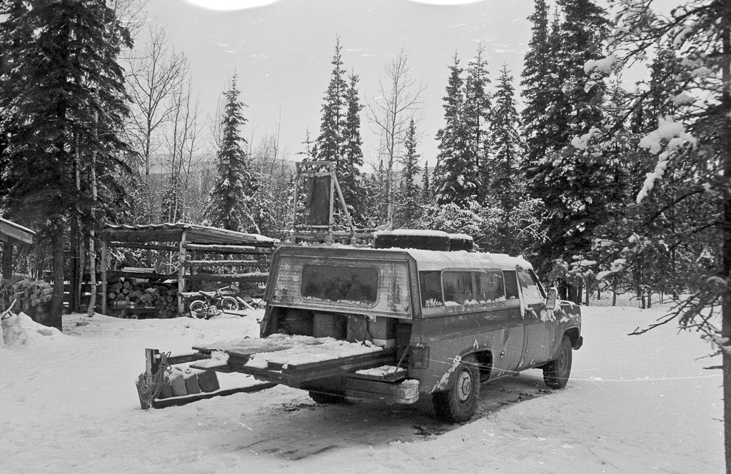pick up likely belonging to Curt, carrying lumber