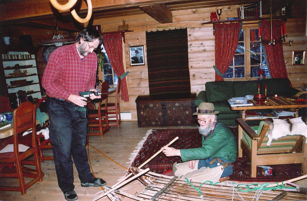 Oliver and Knut,repairing a sled on skiis, Norway