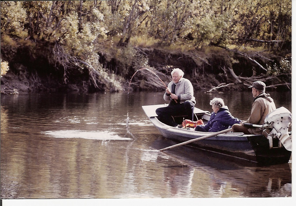photo from Heidi, Oliver with ?? in small river boat with outboard motor