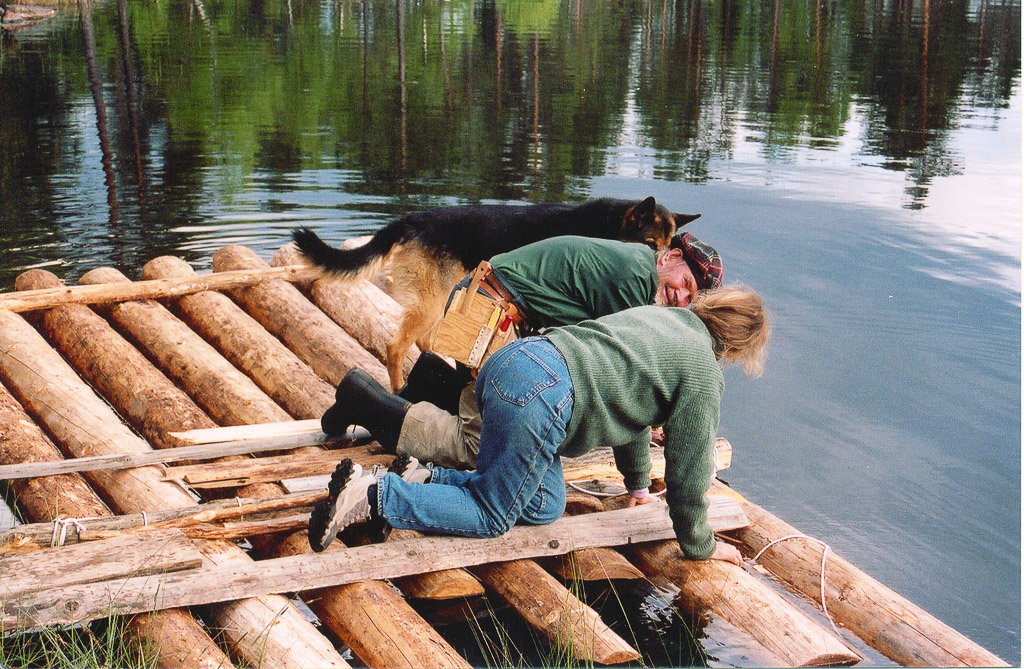 Oliver Cameron and Heidi building raft, Norway